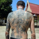 Ajarn Spencer Littlewood  - shows his Pot-Pourri of Sak Yant Thai Temple Tattoos - taken at the Samnak of Luang Pi Pant at Wat Koh Poon in 2007