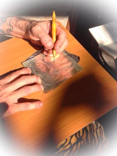 Inscribing sacred Yantra foils on silver Takrut foil